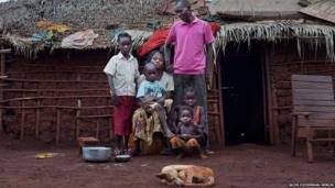 Congolese nurse Anatole Nzu with his wife and four of his six children at their house in the Batalimo refugee camp, Central African Republic
