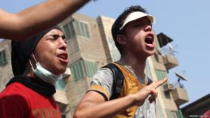 Demonstrators shout tirades against the military's attempts to disperse protest camps