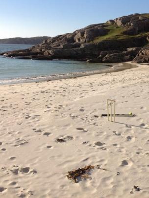 Cricket stumps on a beach