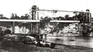 The tubular suspension bridge across the River Wye at Chepstow. This photograph was taken during the construction of the bridge in 1852 © Amgueddfa Cymru – National Museum of Wales
