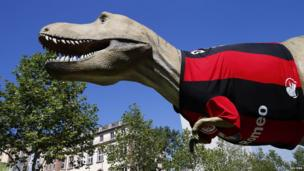 A dinosaur statue in Frankfurt, Germany, in a football shirt - 16 August 2013