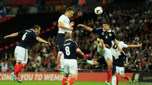 Footballer Rickie Lambert scores a goal with his first touch during his debut for England, in a friendly match against Scotland on Wednesday, 14 August 2013.