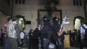 Armed, masked police inside the mosque (17 August 2013)