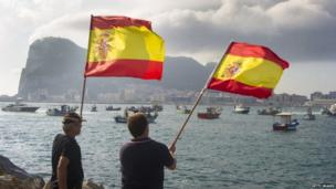Spanish fishermen wave Spanish flags during a protest in the bay of Algeciras