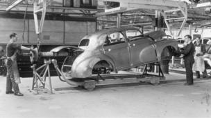 A Morris MO Oxford bodyshell being prepared for the Rotodip rust proofing process