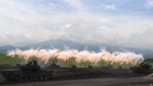 Japanese ground self-defence forces tanks move during an annual live fire exercise at the Higashi-Fuji firing range in Gotemba, at the foot of Mt Fuji in Shizuoka prefecture on 20 August 2013
