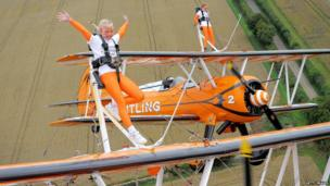 Rose Brewer and Flame Brewer wing-walk over Rendcomb airfield in Gloucestershire, England