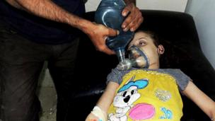 Image provided by Syrian opposition activists purportedly showing a girl receiving treatment at a makeshift clinic in Irbin, Damascus (21 August 2013)