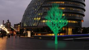 A luminous green tree in a city street
