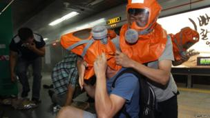Emergency services and civilians take part in a practice exercise to prepare for any potential chemical and biological attacks in Seoul, South Korea.