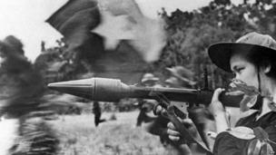Female Vietcong soldier in action with an anti-tank gun during a fighting in southern Cuu Long delta in the frame of the Tet general offensive launched in all the South Vietnam in spring 1968.