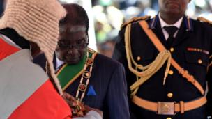 Zimbabwean President Robert Mugabe is sworn in during his inauguration ceremony in Harare on 22 August, 2013 at the national 60,000-seat sports stadium