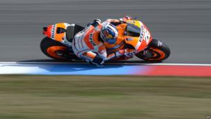 Spanish Moto GP driver Dani Pedrosa rides his Honda during the free practice session of the Czech Grand Prix in Brno on 23 August, 2013.