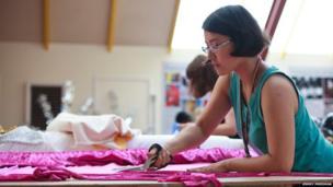 Cutting cloth to make a costume