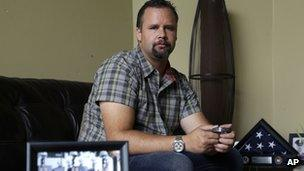 Retired US Army Staff Sgt Shawn Manning poses for a photo, at his home in Lacey, Washington 3 August 2013
