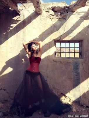 Model in Spain wearing corset