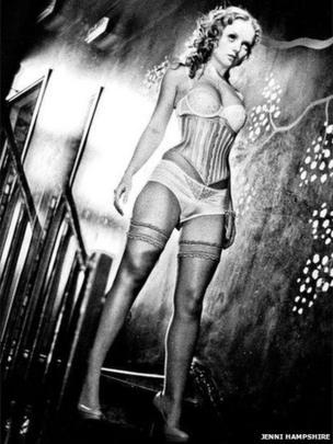 Model poses in corset