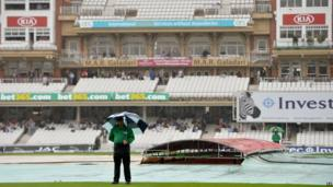 A steward guards the pitch at the Oval