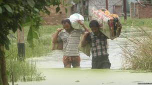 Men walking in flood water