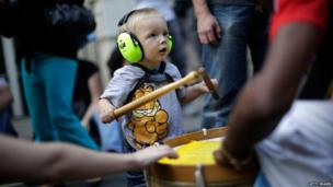 Child wears ear defenders at the Notting Hill Carnival