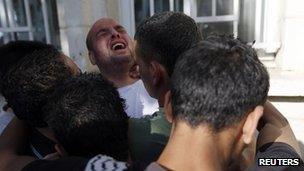 Grieving Palestinians at hospital in Ramallah