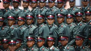 Former Maoist rebels pose for a picture after being integrated as lieutenants into the national army at Nepal Military Academy at Kharipati in Bhaktapur