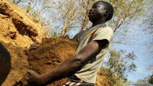 A 13-year-old boy digging and lifting gold ore and other rocks at a small-scale mining site in Mbeya Region, Tanzania. © 2013 Justin Purefoy for Human Rights Watch