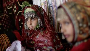 Yemeni girls wear traditional clothes during a birth ceremony in Sanaa