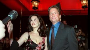 17/11/2000 Associated Press Actor Michael Douglas, and his fiancee, actress Catherine Zeta Jones, pose for photographers outside the Russian Tea Room . (AP Photo/Mitch Jacobson)