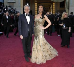 Michael Douglas, left, and Catherine Zeta Jones arrive at the Oscars at the Dolby Theatre, in Los Angeles.