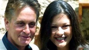 US actor Michael Douglas poses during a photo call with his actress wife Catherine Zeta Jones, during a presentation for proposed summer concerts in Valdemosa, on the island of Mallorca, Spain, where the couple have a vacation home, Tuesday May 15, 2001. (AP Photo/Jaime Reiner)