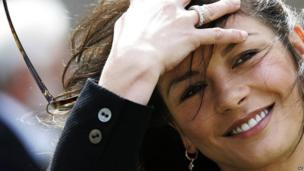 Actress Catherine Zeta Jones gets windswept outside Younger Hall in St Andrews, Scotland, Wednesday, June 21, 2006, after her husband Michael Douglas collected an honorary degree from St. Andrew's University.