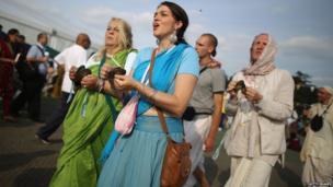 Devotees sing the Hare Krishna mantra during the Janmashtami Hindu Festival at Bhaktivedanta Manor