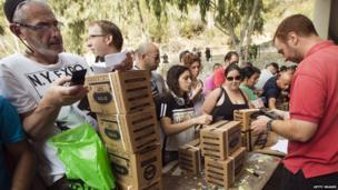 Israelis queue to collect gas mask kits at a distribution centre in Haifa, north of Israel, on 29 August, 2013