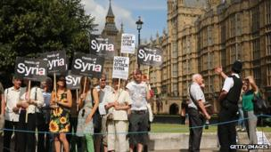 Anti-war protesters outside the Houses of Parliament on 29 August
