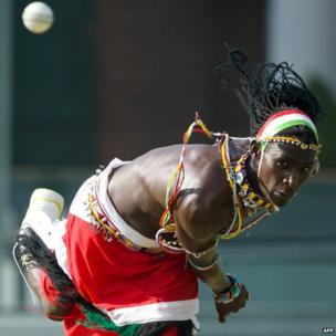 A Kenyan Maasai bowls in a friendly cricket match at Lords Nursery ground in London on 25 August
