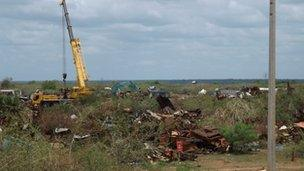 Image of equipment clearing wreckage in Mullivaikkal