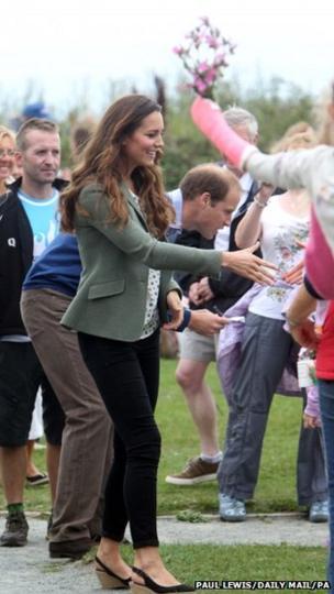 The duke and duchess greet well wishers