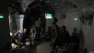 Free Syrian Army fighters rest in their safe house in the old city of Aleppo on 1 September 2013