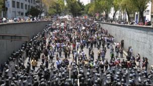 Protesters march through Mexico City on 1 September 2013