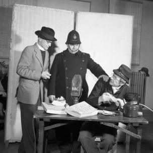 The postmaster (Jon Pertwee) is caught red-handed by the Vicar (David Jacobs) and PC Potts (Norman Shelley) - 1950