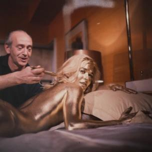 Shirley Eaton being painted gold for the film Goldfinger