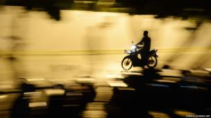A man drives a moped in a street of Maldives's capital Male