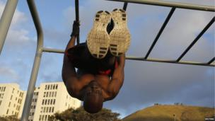 Cape Town resident trains at an outdoor fitness park, South Africa - Monday 2 September 2013