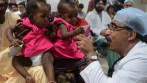 An Indian doctor in New Delhi with conjoined twins who had been separated - Wednesday 4 September 2013