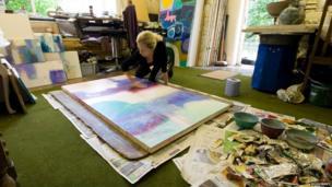 Sara-Jane Harper working on a large canvas at her studio near Wrexham