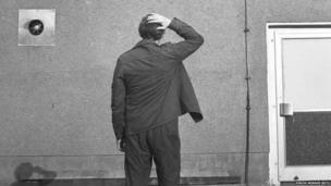Stasi agent giving a secret signal