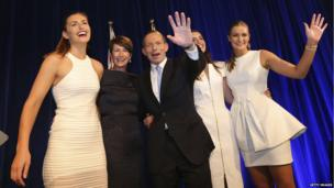 Tony Abbott and his family from right, Bridget, Louise, wife Margaret and Frances wave after he delivered his victory speech on 7 September