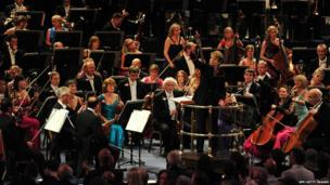 US conductor Marin Alsop conducts the orchestra at the Royal Albert Hall in west London on September 7, 2013 during the Last Night of the Proms