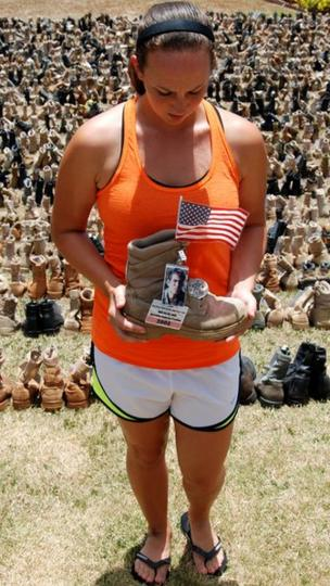 A runner holds one of the boots